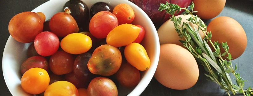 Heirloom cherry tomatoes, red onion, eggs, and herbs
